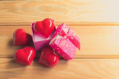 Gift of love. hearty gift. A gift box with a red heart inside. Stock Photo