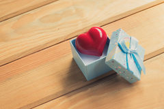 Gift of love. hearty gift. A gift box with a red heart inside. Stock Photography