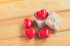 Gift of love. hearty gift. A gift box with a red heart inside. Stock Photos