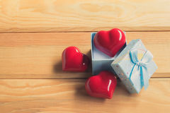 Gift of love. hearty gift. A gift box with a red heart inside. Stock Image