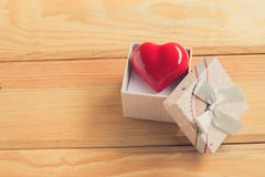 Gift of love. hearty gift. A gift box with a red heart inside. Royalty Free Stock Image