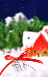 Gift lying in the snow against Royalty Free Stock Images
