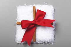 Gift made from snow with red ribbon Royalty Free Stock Photo