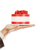 Gift on a male hand Royalty Free Stock Images