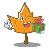 With gift maple character cartoon style. Vector illustration Royalty Free Stock Photo