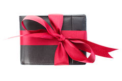 Gift - men's wallet with red ribbon Stock Photos