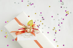 Gift with a message. On a table with decorative stars Stock Image