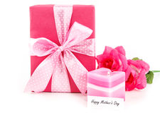 Gift for mom. Pink gift with beautiful bow and tag for mother on white background Royalty Free Stock Images