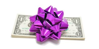 Gift of Money. Stack of American Currency (Dollar Bills) with Purple bow on top stock photos
