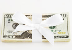Gift of money. Stack of money with a bow around it Royalty Free Stock Photo