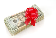 Gift of Money. A gift of money tied in a red bow Stock Photo