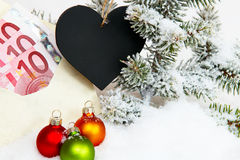 Gift of money for christmas Stock Images