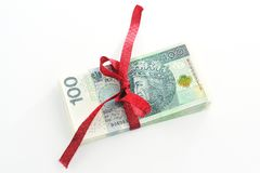 Gift money and Red ribbon. Red ribbon includes money on a white background Stock Images