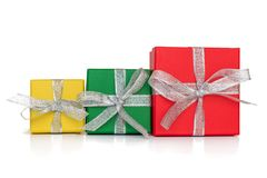 Gift multicolored boxes wrapped in recycled paper with ribbon isolated on white Royalty Free Stock Photos