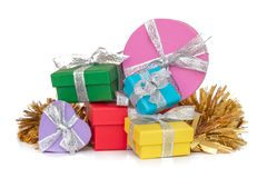 Gift multicolored boxes wrapped in recycled paper with ribbon isolated on white Stock Photos