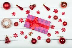 A gift for the new year - a box tied with a red ribbon. Stock Photo