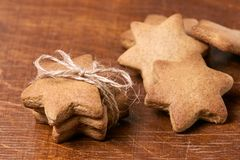 Gift for new year. Delicious dessert. Gingerbread stars. Homemade biscuits Royalty Free Stock Photo