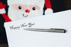 Gift for New year and the letter for friends and relatives. Congratulations happy New Year. The letter and a gift for relatives and friends Royalty Free Stock Photography
