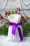 Gift. New Year`s bag with gifts on the snow and background with toys. Royalty Free Stock Photo