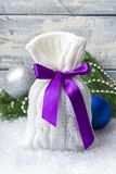 Gift. New Year`s bag with gifts on the snow and background with toys. Royalty Free Stock Image