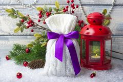 Gift. New Year`s bag with gifts on the snow and background with toys. Stock Photo