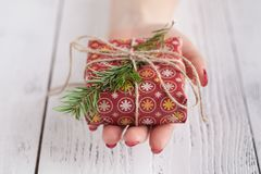 Gift for the New Year on a wooden table. Royalty Free Stock Photo