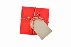 Gift with a note. Label on gift wrapped with red paper tied with string Royalty Free Stock Photo