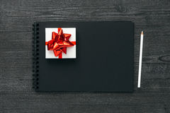 Gift and notebook Stock Photos