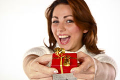 Gift Offer Joy. Conceptual Photo Of A Cheerful Cute Woman Offering A Gift Stock Photo