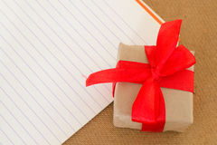 Gift. And old notebook like postcard Royalty Free Stock Photography