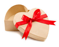 Gift, an open cardboard box. In a heart with red ribbons Royalty Free Stock Photography