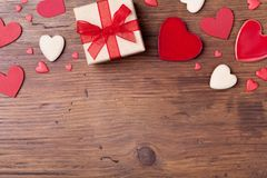 Free Gift Or Present Box And Mixed Hearts For Valentines Day Background. Top View. Copy Space For Greeting Text. Stock Images - 107237584