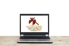 Gift and with origami lucky stars on laptop screen Royalty Free Stock Images