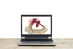 Gift and with origami lucky stars on laptop screen Stock Photos
