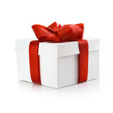 Gift with ornamental red ribbon Stock Photo
