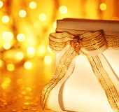 Gift over abstract Christmas lights Royalty Free Stock Photography