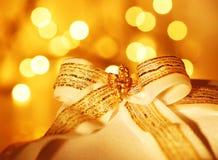 Gift over abstract Christmas lights Royalty Free Stock Image