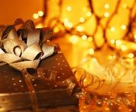 Gift over abstract Christmas lights Royalty Free Stock Photo