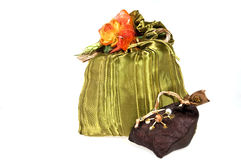 Gift package. In green cloth with orange flowers Royalty Free Stock Photo