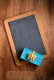 Gift package on the blackboard Royalty Free Stock Images