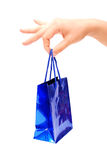 Gift package in a hand. Isolated on a white background Royalty Free Stock Photography