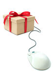 Gift package linked to computer mouse stock photography