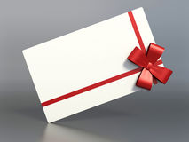 Gift package with a red bow.  Stock Photo