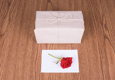 Gift package and red rose Stock Photos