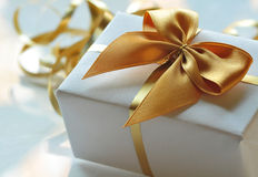 Gift in the package with ribbon Stock Photography