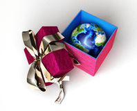 Gift package, with a ribboned open cup, with planet Earth inside, Stock Images