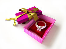 Gift package, with a ribboned open cup, with ring  Royalty Free Stock Image