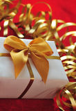 Gift in the package with ribbons Stock Photo