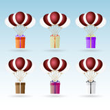 Gift package soaring with helium balloons icons set eps10 Stock Photography