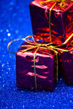 Gift packages on bright blue background Stock Photography